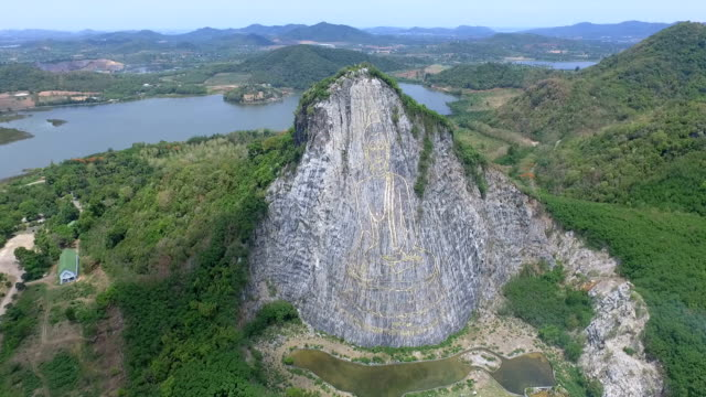 buddha carved cliffs at khao chee chan cliff, sattahip, chonburi province, thailand - chonburi province stock videos & royalty-free footage