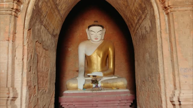 buddha figure inside ancient temple - bagan stock videos & royalty-free footage