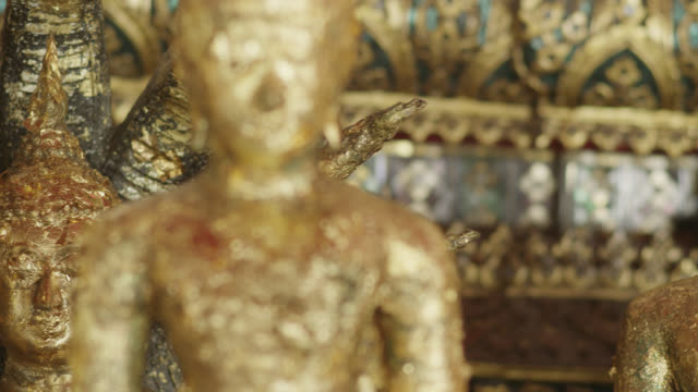cu pan buddha figurines covered r3d 4k in gold leaf, red r3d 4k - male likeness stock videos & royalty-free footage