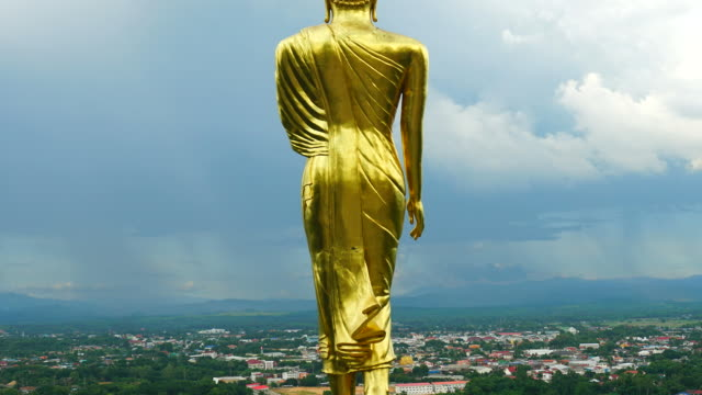 buddha standing on a mountain at morning wat phra that khao noi, nan province, thailand - temple body part stock videos and b-roll footage