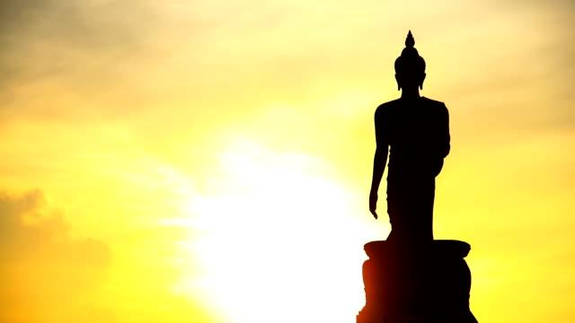 buddha statue and sunset. - buddha stock videos & royalty-free footage