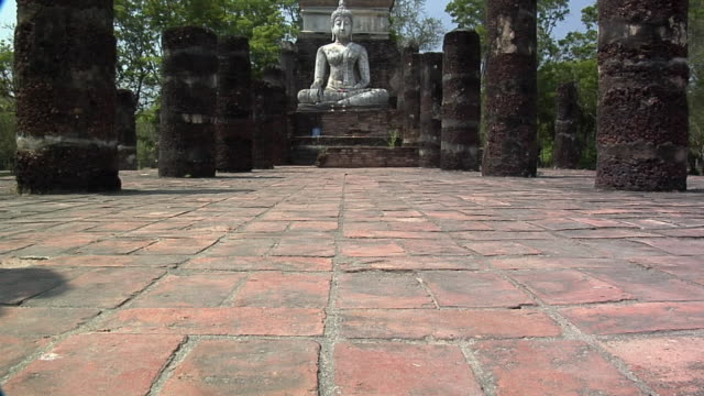 WS TU Buddha Statue at Ruins of Wat in Historical Park of old Sukhothai, Thailand