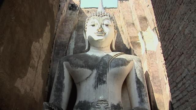 CU ZI LA Buddha Statue at Ruins of Wat Si Cum at Historical Park of old Sukhothai, Thailand