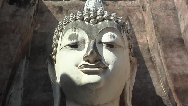 CU ZO LA Buddha Statue at Ruins of Wat Si Cum at Historical Park of old Sukhothai, Thailand