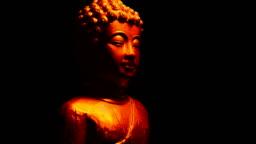 Buddha Statue In Fire Glow