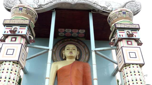 buddha statue in front of angurukaramulla temple, negombo, sri lanka - sri lankan culture stock videos & royalty-free footage