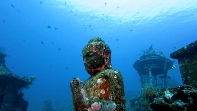 buddha statue undersea, bali, indonesia - indonesia video stock e b–roll