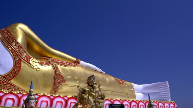pan:buddha statue - pagoda stock videos and b-roll footage