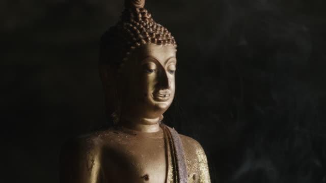 buddha statue with smoke - buddha video stock e b–roll