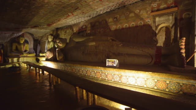 buddha statues at dambulla cave buddhist gold temple indoors, sri lanka - cave stock videos & royalty-free footage