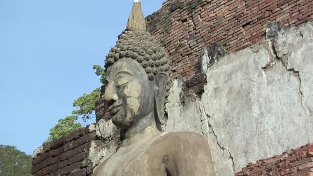 CU ZO WS LA Buddha Statues at Ruins of Wat Mahathat at Historical Park of old Sukhothai, Thailand
