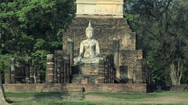 WS ZO Buddha Statues at Ruins of Wat Tra Phang Ngoen at Historical Park of old Sukhothai, Thailand
