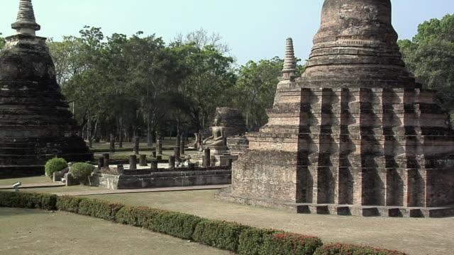 WS ZI MS Buddha Statues at Ruins of Wat Tra Phang Ngoen at Historical Park of old Sukhothai, Thailand