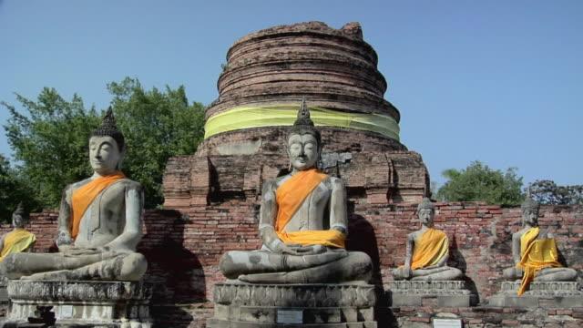 ms zi buddha statues at wat yai chai mongkhon temple / ayutthaya, thailand - male likeness stock videos & royalty-free footage