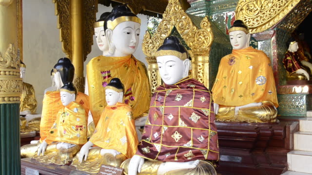 ms buddha statues wearing colorful robes in shwedagon pagoda / yangon, yangon division, myanmar - medium group of objects stock videos & royalty-free footage