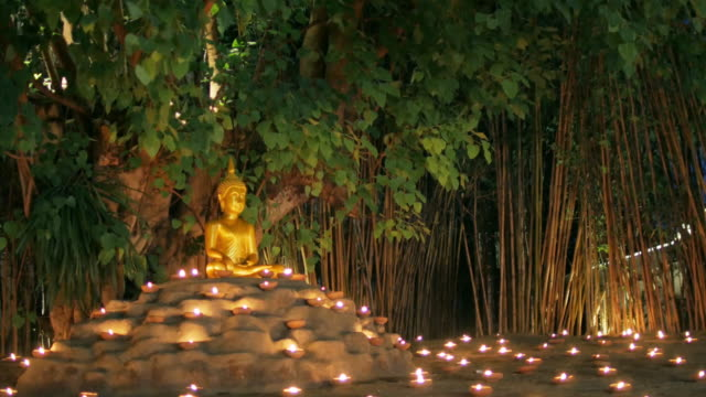 buddhism candle with circle light bokeh in way pan tao chiangmai thailand for background footage design - buddha stock videos & royalty-free footage
