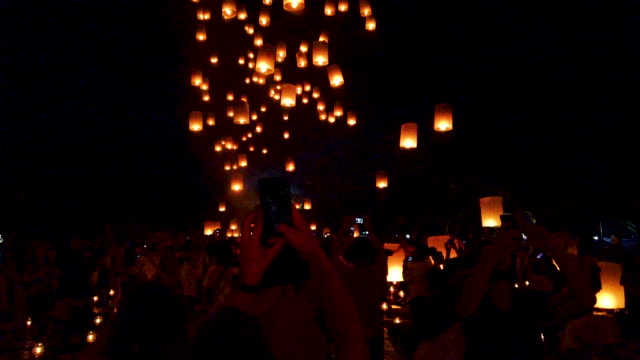buddhist followers and tourists release lanterns into the air on borobudur temple during celebrations for vesak day on may 19 2019 in magelang... - buddha's birthday stock videos and b-roll footage