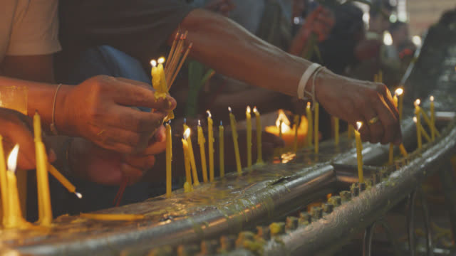 buddhist light the incense sticks at temple - incense stock videos & royalty-free footage