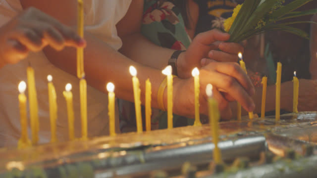 buddhist lights the candle at temple - traditional ceremony stock videos and b-roll footage