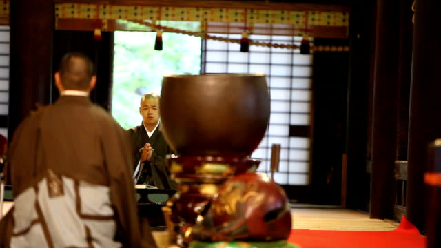 buddhist monk during his morning prayer - lypsekyo16 stock videos and b-roll footage