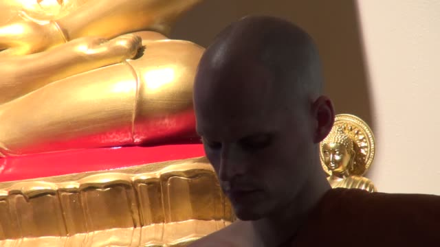 buddhist monk listening to sermon during the last day of vassa celebration at the forest hermitage in warwickshire, england. vassa is a three month... - theravada stock videos & royalty-free footage
