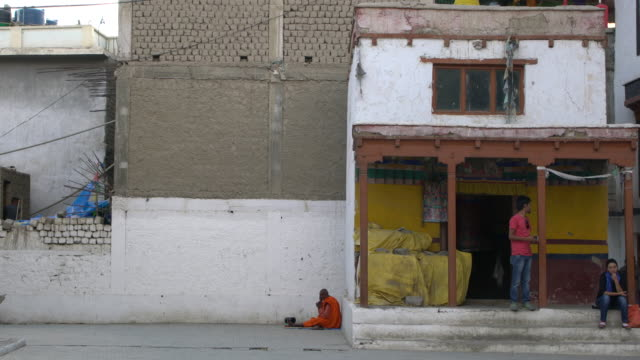 buddhist monk praying at chokhang vihara buddhist temple in leh, ladakh - monk stock videos and b-roll footage