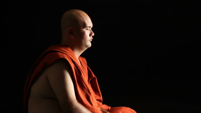 Buddhist monk praying