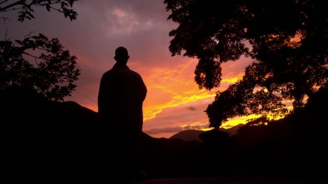 buddhist monk standing in sunset scenery at songgwangsa temple / suncheon-si, jeollanam-do, south korea - ridge stock videos & royalty-free footage