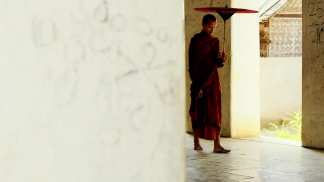 buddhist monk walking in temple anada pagoda - monk stock videos and b-roll footage