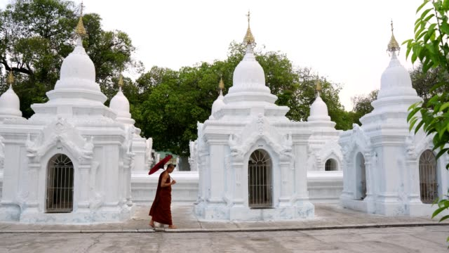 buddhist monk walking in temple - monk stock videos and b-roll footage