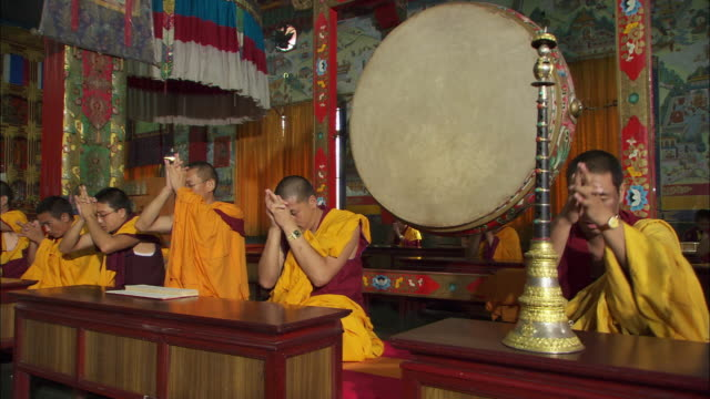 Buddhist monks chant in the Sakya Center monastery in Dehradun, India. Available in HD.