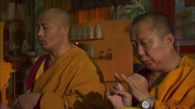 buddhist monks chant in the sakya center monastery in dehradun, india. available in hd. - buddhism bildbanksvideor och videomaterial från bakom kulisserna