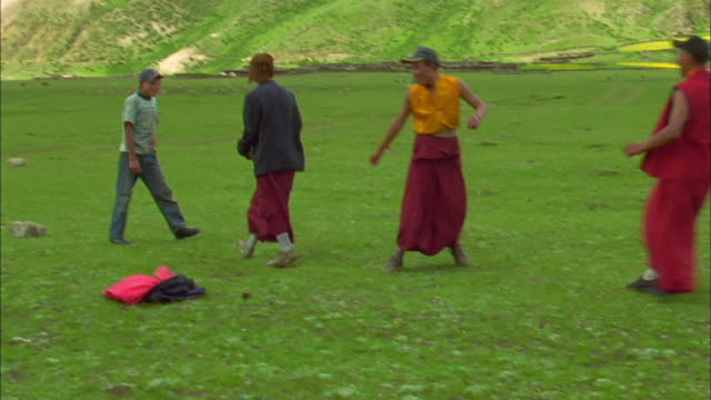 buddhist monks in robes play football, tibet available in hd. - monk stock videos & royalty-free footage