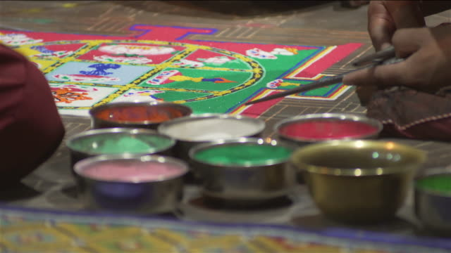 C/U Buddhist monks making a sand mandala