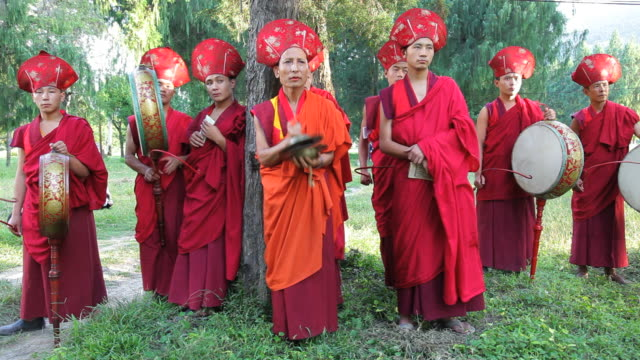 buddhist monks playing instruments at a local ceremony, punakha, bhutan, asia - bhutan stock videos & royalty-free footage