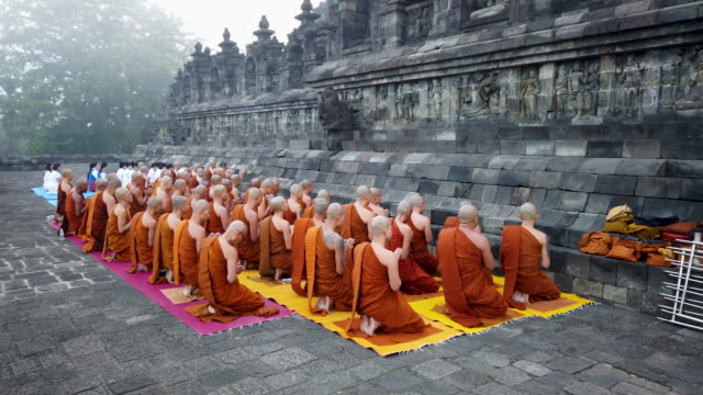 buddhist monks pray at borobudur temple during celebrations for vesak day on may 18 2019 in magelang central java indonesia - buddha's birthday stock videos and b-roll footage