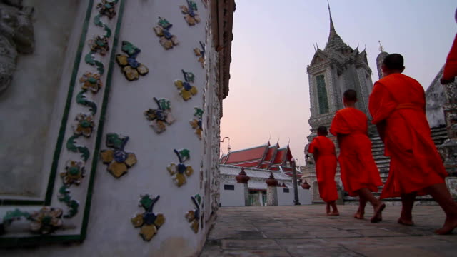 buddhist monks walking to a temple (dollyshot) - bangkok stock videos & royalty-free footage