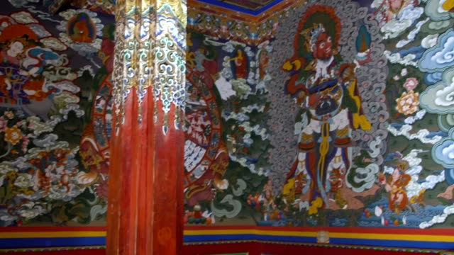 buddhist murals and paintings inside the langjiling temple of gongga, eastern tibet, sichuan, china - buddha stock-videos und b-roll-filmmaterial