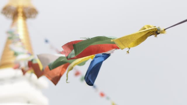 buddhist prayer flags fluttering in the wind - traditionally tibetan stock videos & royalty-free footage