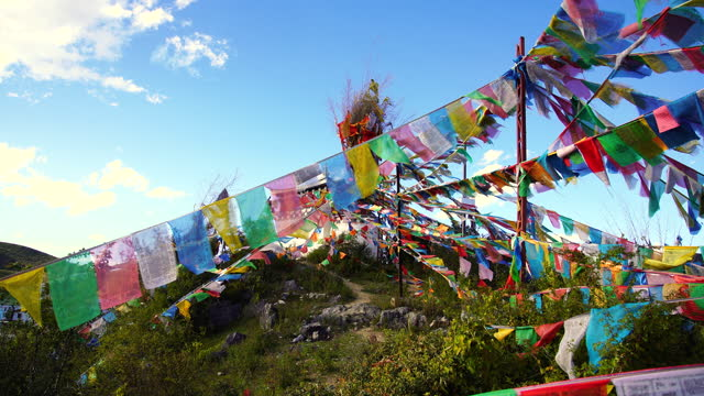 buddhist prayer flags in himalayas - traditionally tibetan stock videos & royalty-free footage