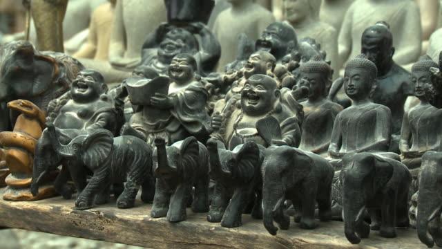 buddhist stone ornamentations in san tok, cambodia - effigy stock videos & royalty-free footage