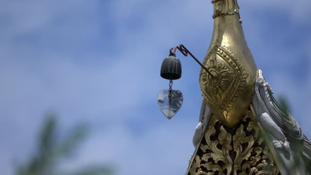 Buddhist temple bell in wind