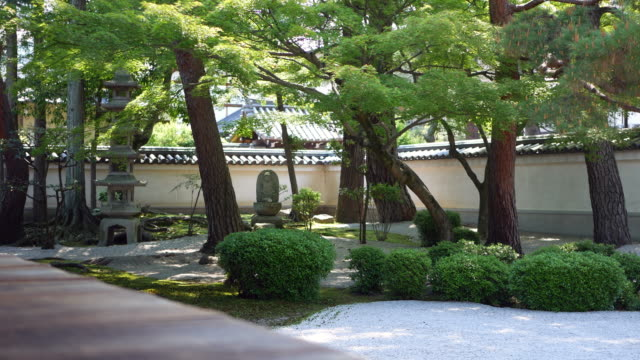 a buddhist temple with a japanese garden - oriental garden stock videos and b-roll footage