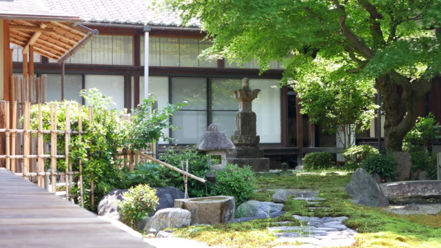 a buddhist temple with a japanese garden - kyoto temple stock videos and b-roll footage