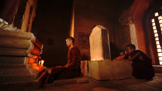 buddist monk make merrit and meditation in ancient temple - buddhism stock videos & royalty-free footage