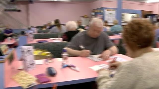 Bingo tax cut to 10 per cent ENGLAND Lancashire Blackpool Empire Bingo Club INT General view of people playing bingo in bingo hall Close shot bingo...