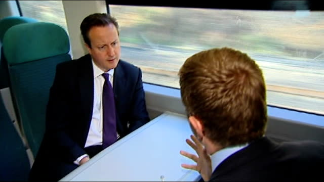 labour and conservatives disagree over pension reforms; england: london: ext people along busy train platform train leaving platform and heading... - worthing点の映像素材/bロール