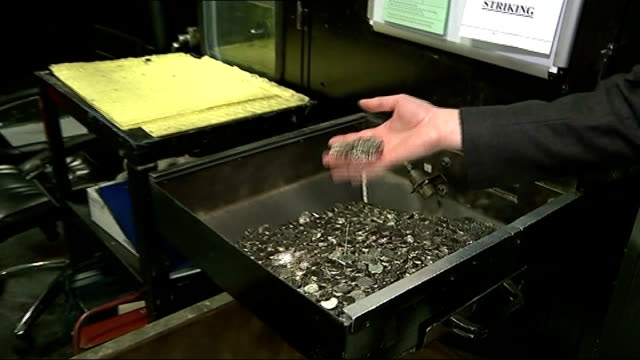 new twelvesided one pound coin unveiled the royal mint int man opening shoot and coins falling into container and covering camera lens close shot... - royal mint stock videos & royalty-free footage