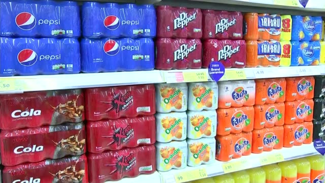 sugar tax; bottles of coca-cola on shelf cans of fizzy drinks including fanta, pepsi, dr pepper and irn-bru on shelf in shop close shot tesco orange... - sugar stock videos & royalty-free footage