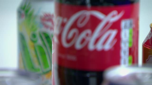 sugar tax; cans of lilt and bottle of cola bottle of fizzy drink being opened - sugar stock videos & royalty-free footage
